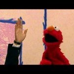 "Elmo with Orman's hand, ""Elmo's World"" segment of Sesame Street, 2001."